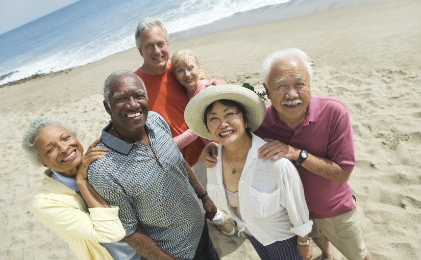 multi-ethnic group of seniors on the beach
